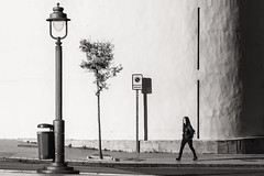 into the light (Gerard Koopen) Tags: spanje spain malaga city bw blackandwhite candid straat street straatfotografie streetphotography woman walking fujifilm light sunshine shadow fuji xpro2 56mm 2017 gerardkoopen