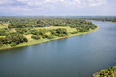 Countryside river with infinity horizon and its far mountains (arnaud_martinez) Tags: alleppey back blue india kerala sky tree water watersedge waterfront boat clouds coconut farm flat forest green horizon houseboat land moutains river wild
