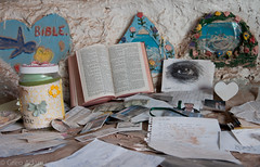 Offerings left at Salvation Mountain (Greg Adams Photography) Tags: salvationmountain niland california southerncalifornia ca calif imperialvalley bible eye offerings book love god color paint hhsc2000 leonardknight godislove roadtrip religion photos ids studentids