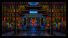 Chinatown, Manchester (Kev Walker ¦ From Manchester) Tags: architecture building canon1855mm chinatown citycentre england hdr lancashire manchester mirrorimage northwest outdoor panorama panoramic photoborder rain reflections postprocessing