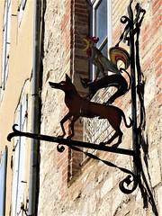 France:  Lauzerte, Tarn-et-Garonne:  veterinary sign (ronmcbride66) Tags: lauzerte tarnetgaronne vet veterinary vetssign sign signage shopsign dog cat cockerel wroughtiron art commercialart urban iron