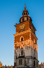 Late Afternoon Sun Hits The Old Town Hall Tower - Krakow Old Town (Stare Miasto) - Market Square (Rynek Glowny) (Olympus OMD EM1 II & M.Zuiko 12-100mm f4 Pro Zoom)  (1 of 1) (markdbaynham) Tags: krakow cracow poland polish city historic famous stare miasto old town market square platz markt rynek glowny pl oly olympus omd em1 em1ii em1mk2 em1mark2 csc evil mirrorless mft m43 m43rd micro43 micro43rd mzd zd mz mzuiko 12100mm f4 pro travelzoom tower tall polska polen royalroute