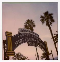 Santa Monica Pier Sign (tobysx70) Tags: the impossible project tip polaroid sx70sonar sonar instant color film for sx70 type cameras impossaroid santa monica pier sign route 66 ocean avenue california ca neon yacht harbor sport fishing boating cafes palm tree silhouette rockford files end of trail rte rt 031017 cromwalk polawalk toby hancock photography