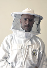 Bee Keeper (miserablespice) Tags: bee keeping buzz workwear beekeeping suit white man