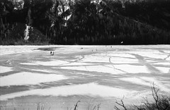 Frozen playground (matej.duzel) Tags: blackandwhite monochrome lake frozen winter film analog canon fd t70 35mm landscape mountain ice cold italy kids playing kite