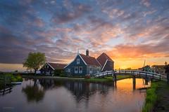 Dutch morning (pieter.struiksma) Tags: netherlands landscape dutch zaanseschans zaandam zaandijk clouds sky sunrise morning burning architecture water reflections