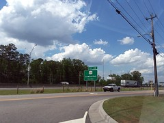 Interstate 95 And Kahn Drive. (dccradio) Tags: lumberton nc northcarolina robesoncounty outside outdoors dominos carryout takeout sky clouds bluesky tree trees greenery interstate95 powerlines powerwires powerpole utilitypole utilitylines utilitywires street pavement interstate exit22 301 traffic van pickup pickuptruck truck semi tractortrailer marten rig whiteclouds billboard streetlight lightpole lamppost intersection kahndrive