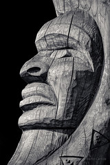 Squamish Nation Totem Pole Detail 2 (martincarlisle) Tags: squamishnation totempoles totems squamish britishcolumbia canada seatoskyhighway highway99 lionsbay horseshoebay woodcarving wood carving detail blackandwhite monochrome blacksky texture face