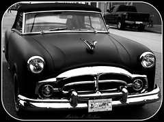 Niiiiiice! (Marcia Portess) Tags: bw cars vancouver blackwhite vehicles chrome carros oldcars classiccars automobiles coches convertibles grills coolcars automoviles beautifulbritishcolumbia niiiiiice vancouverbccanada blackcars 1954packardcavalier classiccustomcar marciaportess marciaaportess