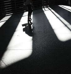 Dissolved Girl (Angel Salguero) Tags: madrid camera shadow girl spain trainstation atocha elongated iphone5