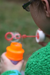 Blowing Bubbles (Vibeke Sonntag) Tags: boy colour green canon children fun play bubbles blow