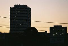 Downtown (MoreFunkThanYou) Tags: city sunset sun nature car architecture 35mm nikon cityscape rally australia mg nighttime 35mmfilm canberra analogue agfa mazda 35 rx7 35mmphotography sunflare nikonf5 agfavista200 analoguephotography canberracity morefunkthanyou