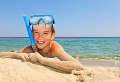 Boy on a beach (Dmitri Naumov) Tags: blue boy sea summer vacation portrait sunlight cute beach nature water smile face wearing childhood smiling fun outdoors happy seaside kid sand day sardinia snorkel child looking mask little sandy joy young relaxing lifestyle gear snorkeling leisure recreation activity cheerful lying seashore enjoyment swimwear oneperson caucasian scubamask