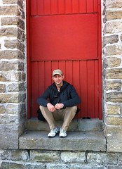 on a doorstep (Mr.  Mark) Tags: door red ontario brick me stone wall self pose photo stock steps sit doorstep merrickville markboucher