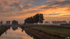 Early autumn, landscape for sunrise (BraCom (Bram)) Tags: morning trees mist holland reflection fog clouds sunrise canon landscape bomen ditch farm widescreen nederland thenetherlands meadow wolken windmills dijk polder 169 dike weiland ochtend landschap sloot boerderij middelharnis goereeoverflakkee windturbines greenenergy spiegeling windmolens devlieger southholland zonsopkomst canonef24105mm bracom groeneenrgie canoneos5dmkiii