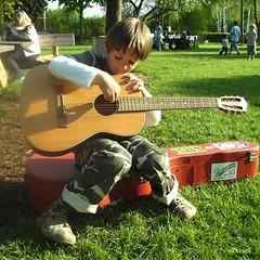guitar lessons outside (mknt367 (Panda)) Tags: boy playground kids t outside guitar 2008 guitarlessons