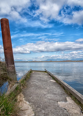 The Old Dock (Coral Norman) Tags: landscape sky delta ladner canada nikon d750 bc april spring dock water fraser river old dilapidated abandoned floating cement grass clouds blue