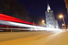 Dublin at Night (Colin Kavanagh) Tags: night nighttime nightlights nightlife traffic motion cathedral stpatrickscathedral patricksstreet ireland dublin visitdublin lighttrail street architecture building lights lowpov lowangel low looking up