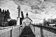 church of mary, st. joseph island, ontario (twurdemann) Tags: architecture blackandwhite church churchofmary clouds fujixt1 highway548 hill marker munuscongchannel navigationlight niksilverefex ontario rangelight rural sailorsencampment sky snow spring stjosephisland stmarysriver stairs steeple woodframe xf1855mm