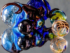 Glazed glass marbles (marcy0414) Tags: macro macromonday macromondays glaze marbles glass mirror