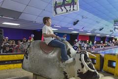 Boy on a Bull (aaronrhawkins) Tags: bull mechanical ride classicfuncenter skate family boy fall audience fun kid child children sandy utah joshua daring dare holdon slip spin aaronhawkins cowboy