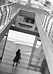 Shopping (saxild) Tags: nikon n80 f80 nikkor 85mm 85mm18d kodak tmax tmax400 plustek 7600 scanner analog film woman shopping shoppingcenter waradero grancanaria spain street streetphoto