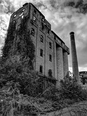 Frau Blucher! (photography_isn't_terrorism) Tags: bw abandoned neglected smokestack distillery cloudy moody dark hdr