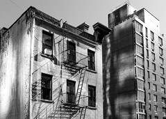 From the High Line (D. Coleman Photography) Tags: high line park nyc new york city manhattan chelsea meatpacking district buildings architecture urban cities fire escape modern old design black white shadows