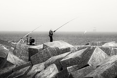 Gotcha ! (wimkappers) Tags: blackwhitephotos bw people monochrome fisherman sea pier candid