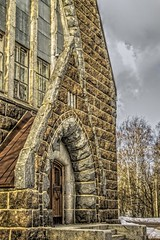Old Finnish Church in spring (mikhafff1984) Tags: church building cross tower cathedral brick arch stone nobody flowers copy spring christian sunny contemporary easter architecture catholic sky religion beautiful space belfry christianity