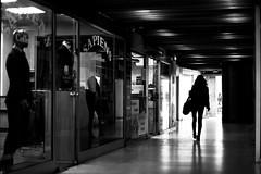 Along shop windows (pascalcolin1) Tags: paris13 femme woman vitrines shopwindows shops magasin manequin ombres shadows lumière light couloir corridor photoderue streetview urbanarte noiretblanc blackandwhite photopascalcolin dummy