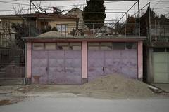 Garage Doors, Veles (Duncan R S Harvey) Tags: europe easterneurope southerneurope balkans macedonia veles garage door doors dirt pile street pink faded fyrom