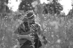 Playing ukulele (zairasandionigi) Tags: field man portrait hat ukulele playing nature park afternoon italy model