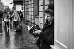 The Riveting Read (Leanne Boulton) Tags: monochrome people portrait urban street candid portraiture profile streetphotography candidstreetphotography candidportrait streetportrait streetlife woman female girl face facial expression look emotion feeling mood atmosphere weather rain raining book reading paper novel tone texture detail depthoffield bokeh naturallight outdoor light shade shadow city scene human life living humanity society culture canon canon5d 5dmarkiii 70mm character ef2470mmf28liiusm black white blackwhite bw mono blackandwhite glasgow scotland uk