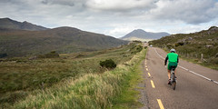Cyclist at Moll's Gap mountain pass (Joe Dunckley) Tags: countykerry ireland kerry killarney killarneynationalpark mangertonmountains mollsgap r658 republicofireland cycling cyclist landscape mountain mountainpass nature person road transport transportation