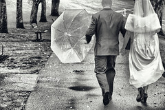 All Blues (Theodora Kalavesis) Tags: wedding weddingdress groom bride bridegroom photography weddingphotography britishcolumbia bc blackandwhite blackwhite raining umbrella walking theodorakalavesis theodorakalavesisphotography canada vancouver