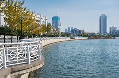 Shoreline along the Haihe River, Tianjin, China (Victor Wong (sfe-co2)) Tags: bank blue bridge buildings china city clouds cityscape commercial construction district downtown exterior haihe highrise landmarks landscape modern oriental outdoors overlooking public railway recreation river scenery shoreline sky square station streets symbol tianjin tourism travel urban vision walkway white zhigu