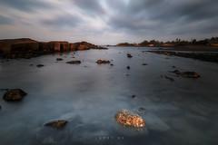 AGAINST ALL ODDS (jopetsy) Tags: sual pangasinan sunrise sunset seascape landscape fujifilm fuji philippines rain rock stones pebbles