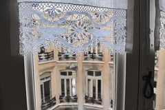 lace curtain in La Pedrera (Jwaan) Tags: lace curtain tat lapedrera architecture old history turnofthecentury barcelona spain victorian window coverings courtyard