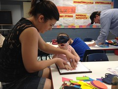 "Volunteer Samantha works with BELL participant Miranda on tracking braille with good non visual techniques. • <a style=""font-size:0.8em;"" href=""http://www.flickr.com/photos/29389111@N07/9544529528/"" target=""_blank"">View on Flickr</a>"