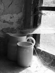 Jugs in the window , Tyneham Village (Hammerhead27) Tags: old uk shadow blackandwhite history window glass urn rural mono farm web ghost tourist dorset jug purbeck relic frozenintime tynehamvillage tynehamtanks