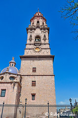 Towering (ilikethesnakeonyourtattoo) Tags: old city family flowers blue trees windows red sky building tower art home church glass beautiful beauty architecture lady bells photoshop fence de grande high interesting morelia shadows frolic arte dynamic cathedral unique branches details towers centro large angles catedral iglesia peaceful ciudad bluesky tourists structure sharp clear handcrafted marble straight guadalupe dowtown range railings detalles socool touring towering favoriteplace hogar catolicos vivamexico artesanos catholics significance hometowns moreliamichoacan artedemexico rubygonzalezphotography elcorazondemichoacan