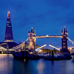 The Shard and Tower Bridge (Andrew Tan 2011) Tags: uk bridge england reflection london water thames skyline architecture skyscraper towerbridge river cityscape open unitedkingdom ships landmark drawbridge tall bluehour drawn wapping thamesfestival towerhill artificiallight theshard thechallengefactory ashipsopera