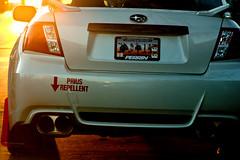 Prius Repellent (tommaync) Tags: auto red car silver mirror nc nikon automobile january southcarolina northcarolina licenseplate prius subaru bumpersticker orangecounty chapelhill tailpipe taillight repellent exhaustpipe 2014 d40