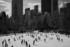 Ice Skating (dsavvakos) Tags: park new york nyc sky bw usa ice zeiss 35mm landscape sony skating central a7r landsapce
