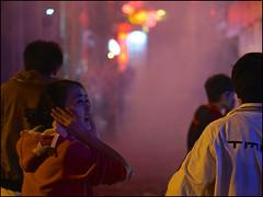 Bang ! (Christian Lagat) Tags: china woman night smoke femme chinesenewyear  kunming yunnan bang nuit firecrackers chine fume  boum  nouvelanchinois ptards sonynex6