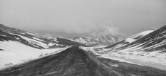 A Land of Ice and Fire (lunaryuna) Tags: iceland centralnorthregion myvatnarea volcaniclandscape geothermalactivity steaminglandscapes fireandice relapseintowinter road travel journey voyage ontheroad mountains snow landscape weathermood blizzard blackwhite bw monochrome panoramicviews panorama lunaryuna