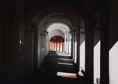walking through shadows (cherryspicks (on/off)) Tags: shadows light arches architecture colonnade column passage prague city urban