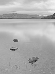 Loch Maree (ShinyPhotoScotland) Tags: airy art awe balance beautiful blackandwhite boulder calmstill circularpolariser clouds darktable digikam digitalgradnd digitallowpass digitalred dulllight elegance emotion filter focusstacked gimp highlands idyll intimatelandscape inviting landscape landwater light lochmaree longexposure lump meaningemptiness memories moment monochrome nature nearfar nearmidfardistance negativespace nisi numbers numinous olympus1240mmf28 olympuspenf peace photography places point pure rockstone rockwater rules scotland serene shapeandform simple sky skyearth slattadale space striking submerged three timelessness toned tonemapped tranquil uplifting vintage vista water westerross zen