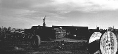 The Statue of Liberty turns her back on hundreds of acres of abandoned piers, forgotten and forlorn buildings, discarded truck tires and tons of dumped waste. Deep inside Liberty State Park. (well, not quite yet). Jersey City. October 1977. (wavz13) Tags: oldphotographs oldphotos 1970sphotographs 1970sphotos oldphotography 1970sphotography vintagephotographs vintagephotos vintagephotography filmphotos filmphotography newyorkphotographs newyorkphotos oldnewyorkphotography oldnewyorkphotos vintagenewyork secretplaces hiddenplaces depressing bleak noir noire dark oldbuildings vintagebuildings abandonedbuildings jerseycityphotographs jerseycityphotos oldjerseycityphotography oldjerseycityphotos oldjerseycity vintagejerseycity vintagejerseycityphotography jerseycityhistory urbanphotography urbanphotos urbanscenes cityphotography cityphotos newjerseyphotographs newjerseyphotos oldnewjersey vintagenewjersey newjerseyhistory vintage35mm old35mm grain grainy industrialwasteland urbanwasteland newyorkharbor urbandecay urban urbanexploration industrialjerseycity